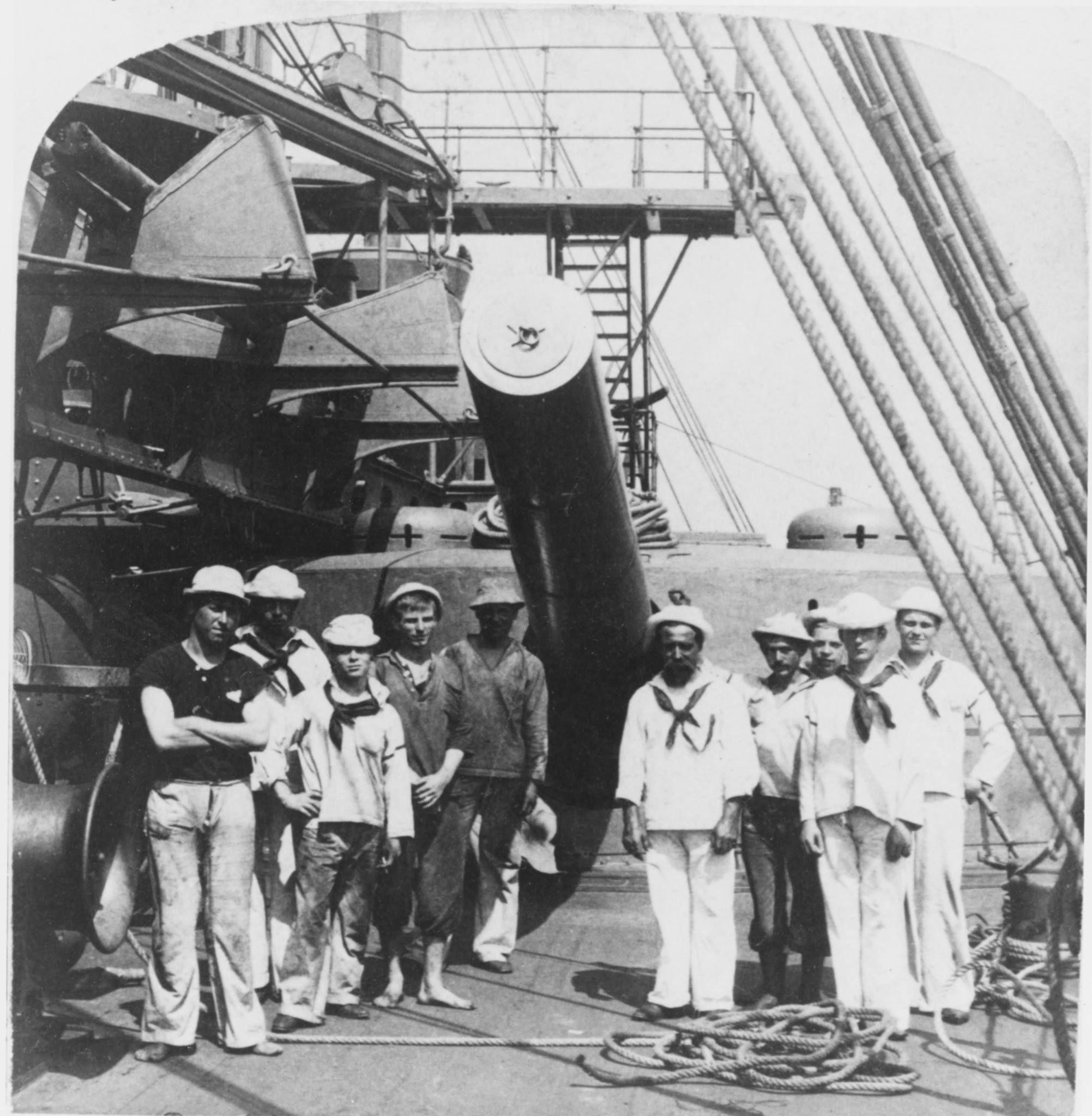 USS Texas crewmen pose in front of the battleship's port
