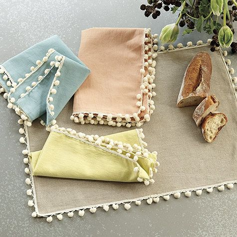 The fresh summer colors of our Mali Pom Pom Placemats are designed to coordinate with our popular Belize Napkins.