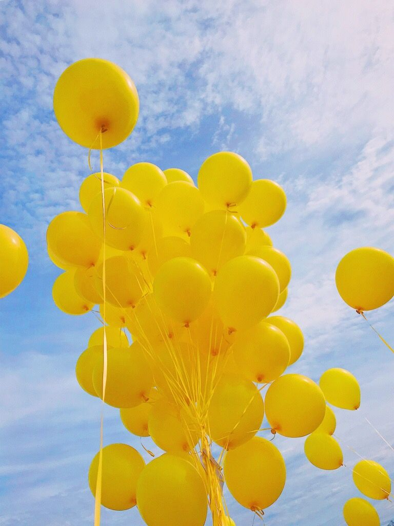 yellow balloons and a blue sky for our sweet maddi with