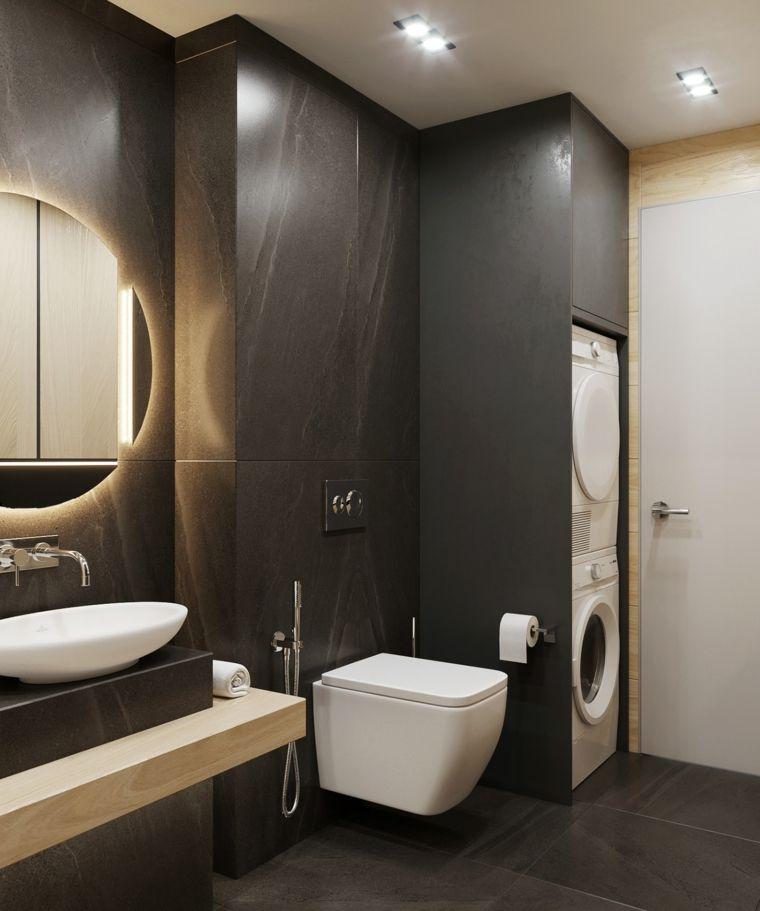 Idee bagno piastrelle di colore nero lavanderia da incasso nella parete e rivestimento legno di for Idee bagno moderno