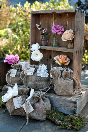 Burlap Beauty: These baby burlap sacks remind me of farm feed bags. The bright flowers make the more neutral elements of the tablescape work.    Photos by Erik Ekroth via StyleMePretty