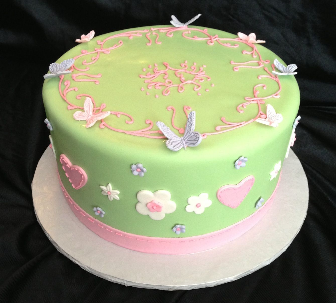 Pink, green and lavender baby girl shower cake. Baby