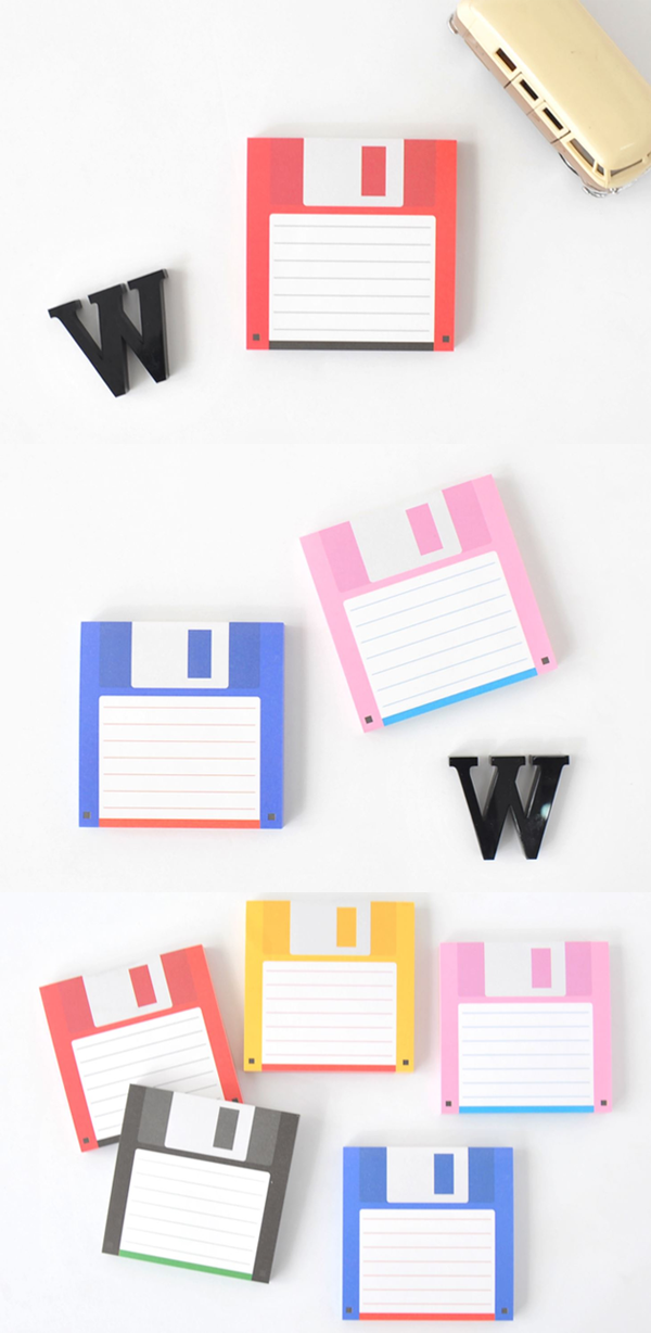 Save As Icon This Is A Picture Of A Floppy Disk With A Pencil On Top That Seems To Be Writing Something The Disk Has A Chipped Side On Icon Save