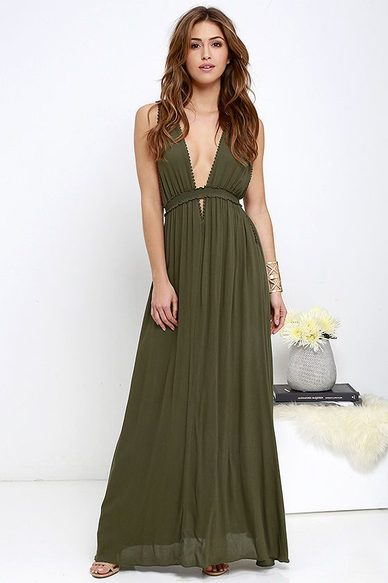 All the ladies of Mount Olympus are giving rave reviews to the Greek Goddess Olive Green Maxi Dress! Soft woven rayon drapes into a V neck and back, broken up by a smocked empire waist trimmed in cute pompom embroidery. Full maxi skirt sways below cute cutouts.