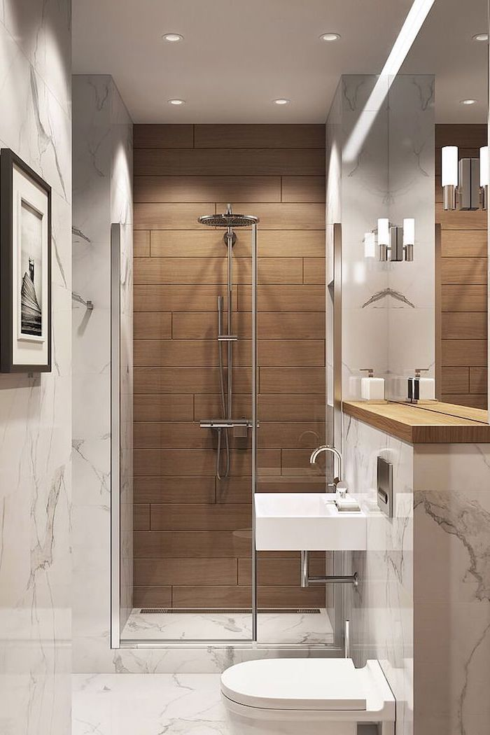 How To Decorate A Bathroom Brown Tiled Wall Marble Walls Floor White Floating Sink Wooden Shelf In 2020 Small Bathroom Makeover Small Bathroom Bathroom Design Small
