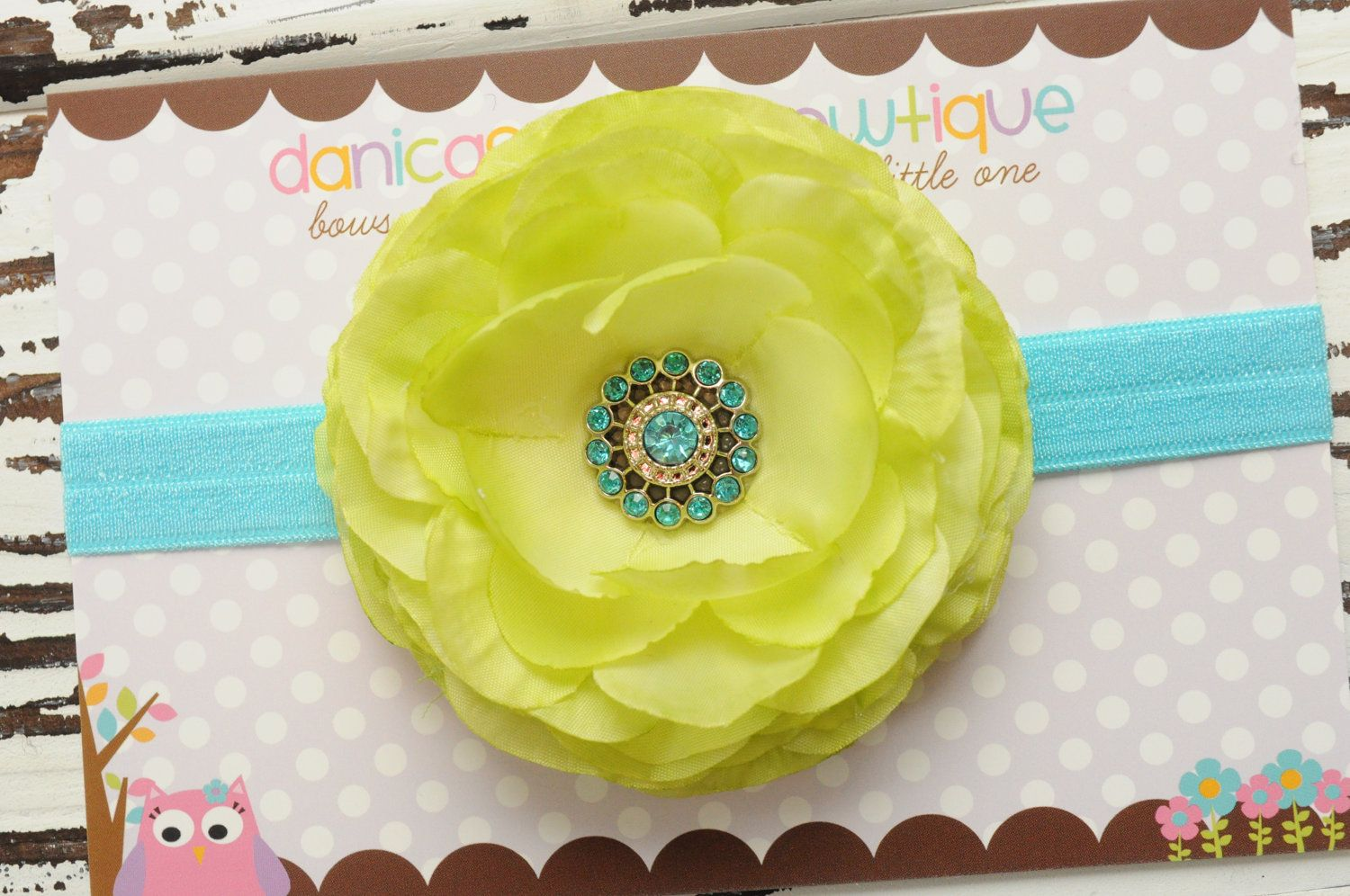 Lime and aqua flower headband with fancy center- newborn, infant, child, teen or adult sizes. $12.00, via Etsy.