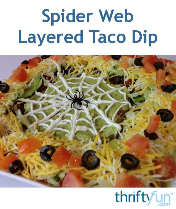Spider Web Layered Taco Dip #halloweenpotluckideas
