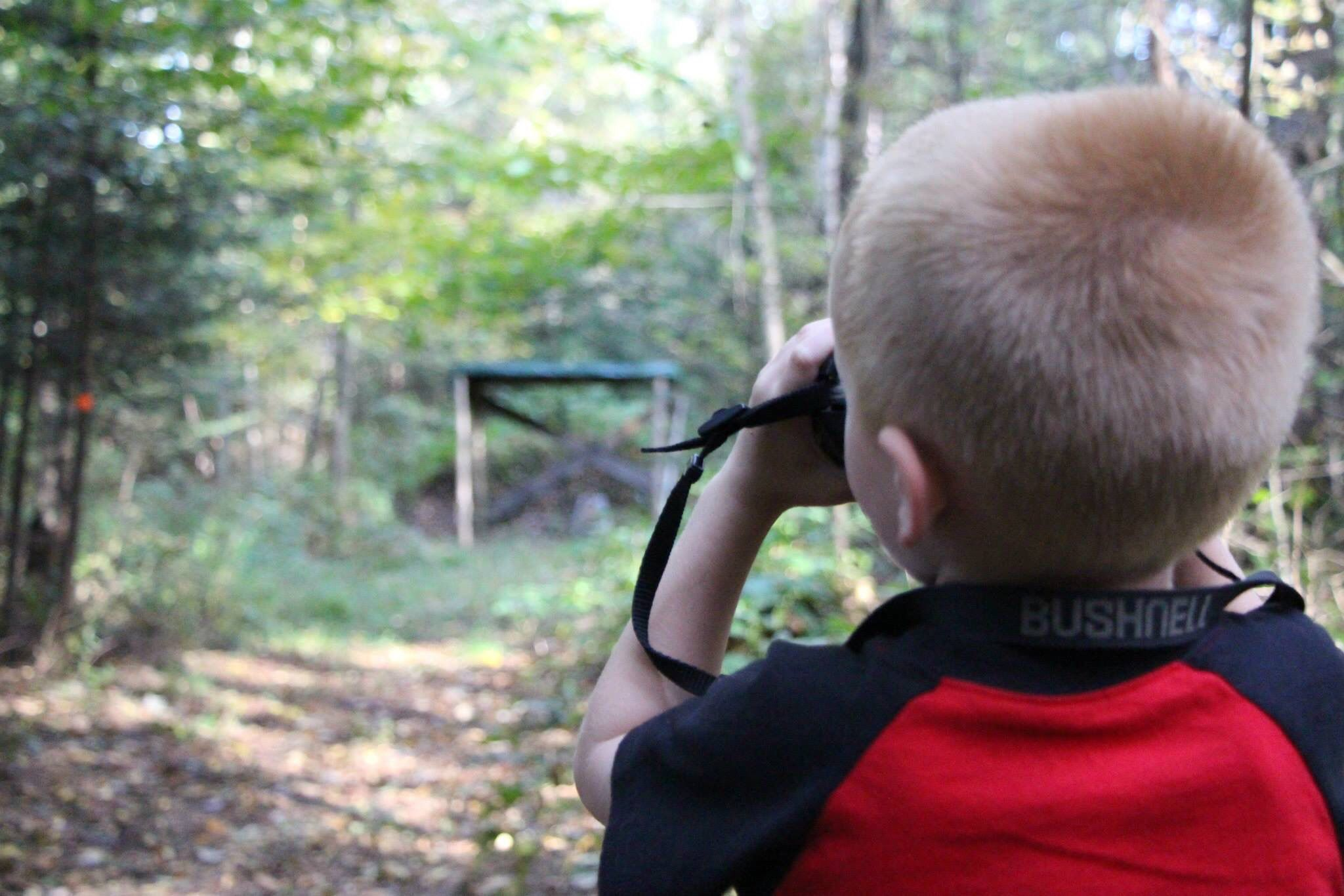 My youngest son trying out a range finder.  Sometimes hunting interests can start at a young age.  Teach them correctly from the beginning and keep their interest up.