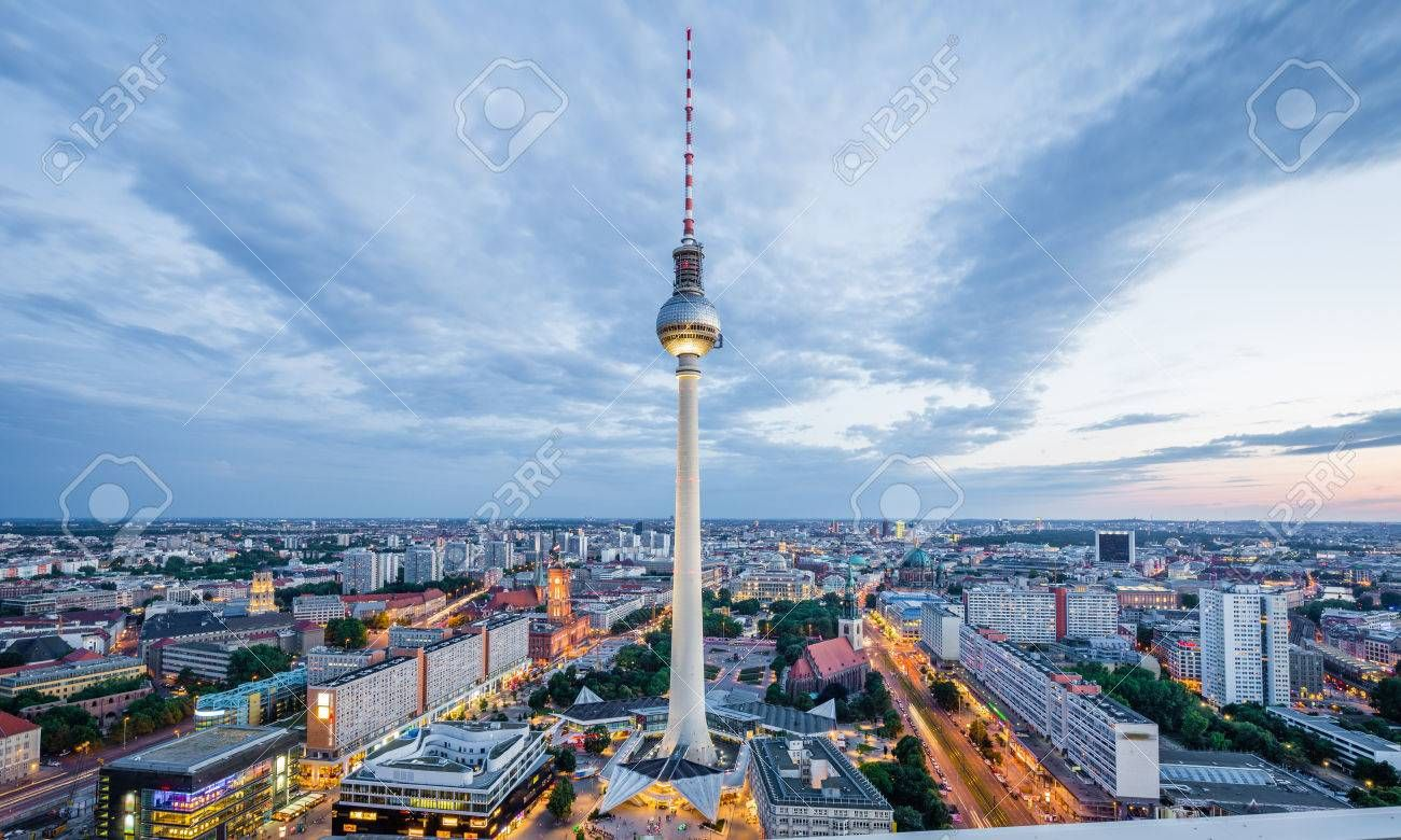 Aerial View Of Berlin Skyline With Famous Tv Tower At Alexanderplatz And Dramatic Cloudscape In Twilight During B In 2020 West Berlin Popular Travel Destinations Tower