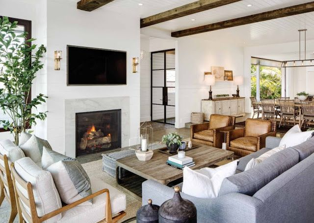 Interior Designer Kari Arendsen Chose Reclaimed Beams From Vintage Timberworks For The Living Area Around An RH Coffee Table Ralph Lauren Home Armchairs