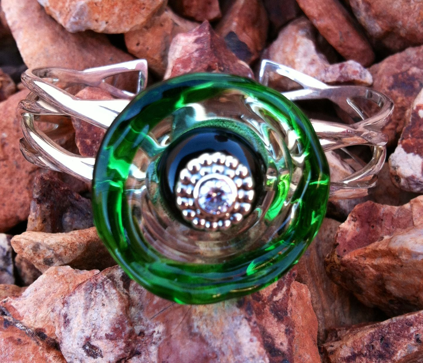 One of my Italian Glass beads formed into disk and used in my Marcus Max Sterling Silver Cuff.