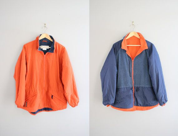 Reversible Columbia Jacket Orange Windbreaker Fleece Jacket Cinched Waist Parka Unisex 90s Vintage Sport Size M - L #T023A  ✂-----F e a t u r e s---------------- Reversible Columbia orange windbreaker with minimalist design on one side, and fleece on the other side. Unisex friendly.   fits like : M - L condition : Excellent ✂------m e a s u r e m e n t s----------------  (inches) * chest : 50 * shoulder : 19 * sleeve : 25 * total length : 29     T023A