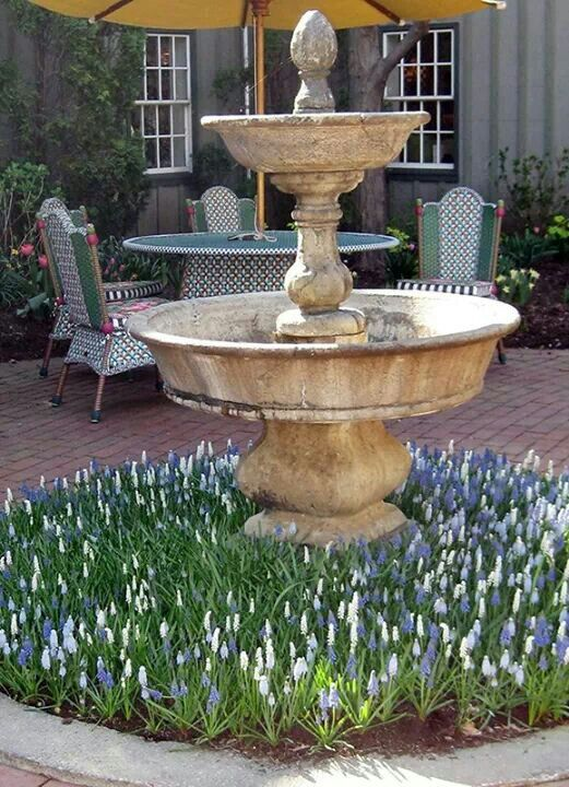 Planting Around The Fountain Mackenzie Childs Aurora Ny Landscaping With Fountains Garden Fountains Backyard Landscaping