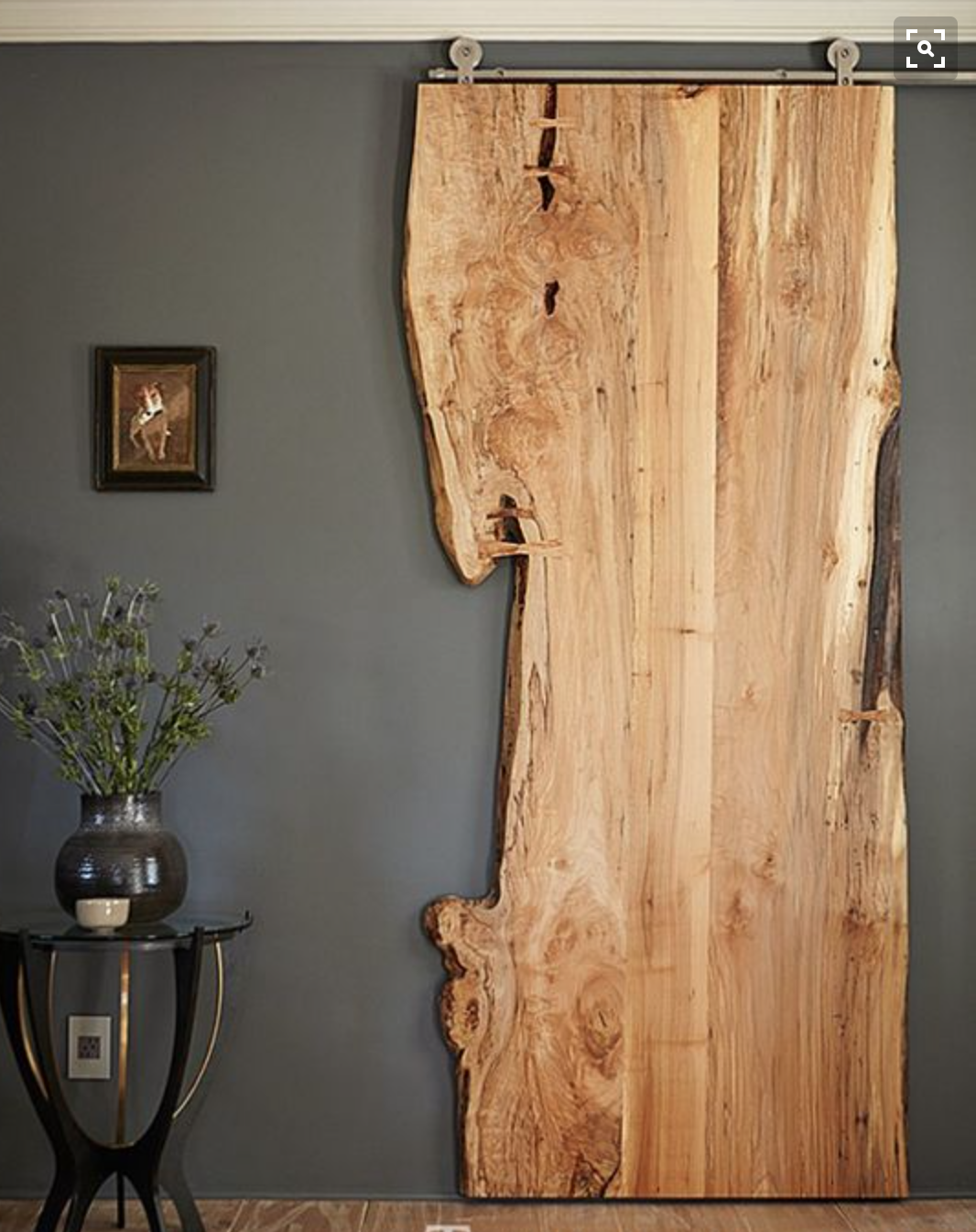 Perhaps a cool slab of wood installed on the wall in the powder room?  One from the site?