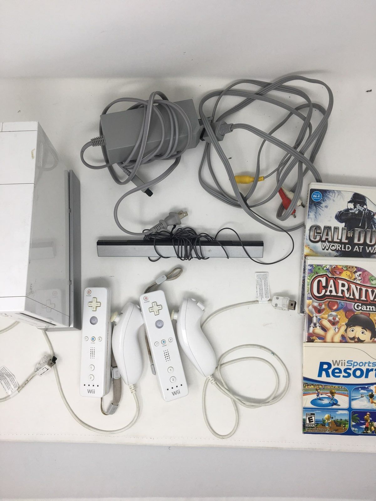Wii console and 2 Wii controllers, with nunchucks and all