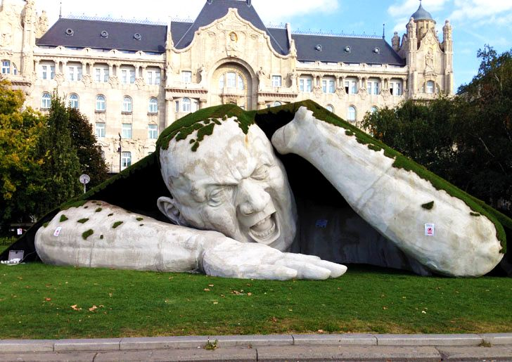 Giant Ogre Sculpture Rips Out of Lawn in Budapest