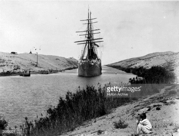 A French frigate passes through the Channel of the Suez Canal, opened in 1869