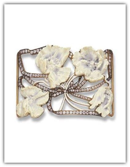 RENE LALIQUE | AN ART NOUVEAU DIAMOND AND GOLD DOG COLLAR PLAQUE. Of rectangular outline, the openwork plaque set with four carved French ivory hawthorn flowers, each stained with blue, with white enamel stems, enhanced by old European-cut diamond undulating ribbon motif, mounted in 18k gold, circa 1902.