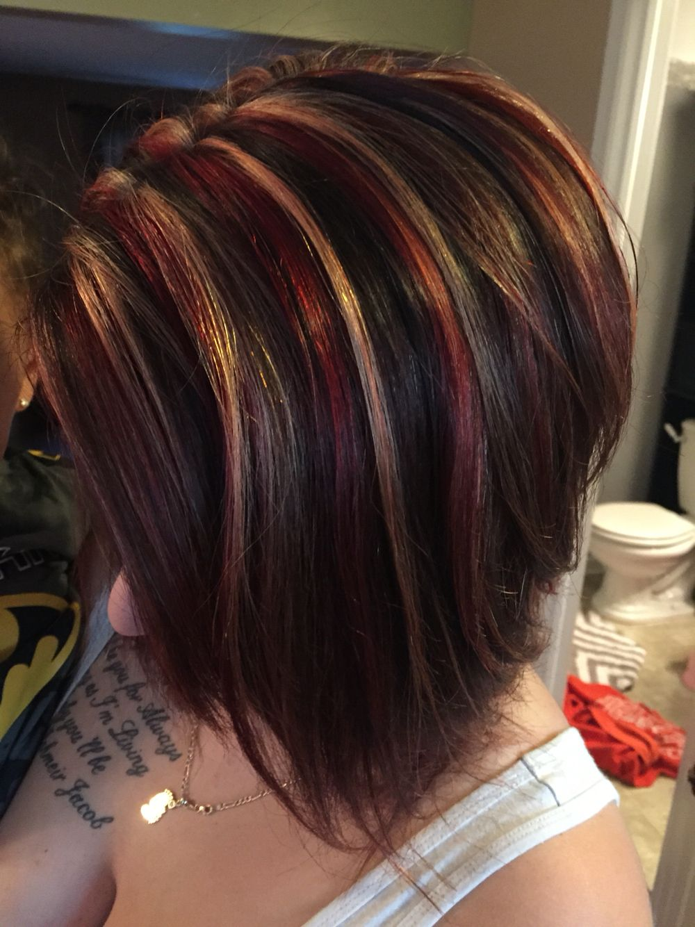 Red blonde chunky highlight on dark base hair color in