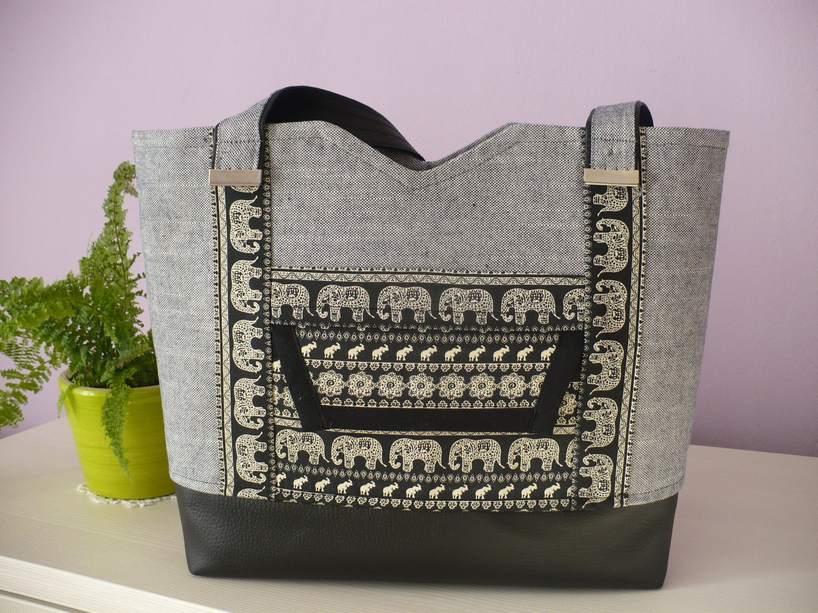 Smaller handbag with elephant pattern