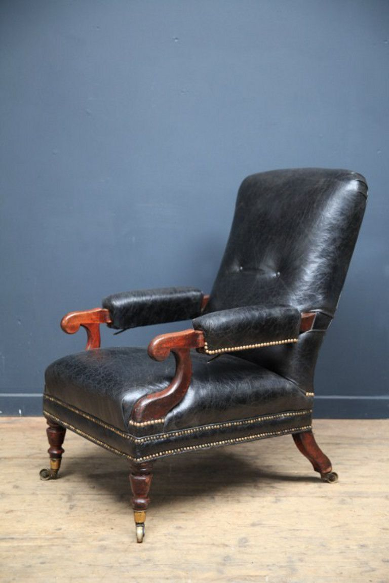 A Black Leather Reclining Library Armchair Raised On Quality Brass Castors English Second Half Of The 19th Cen Armchair Armchair Vintage Dinning Room Chairs