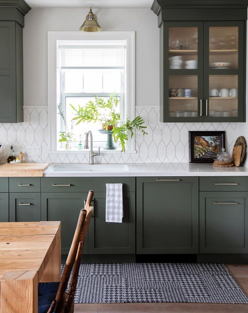Love the muted dark green kitchen cabinets and cool hexagon style