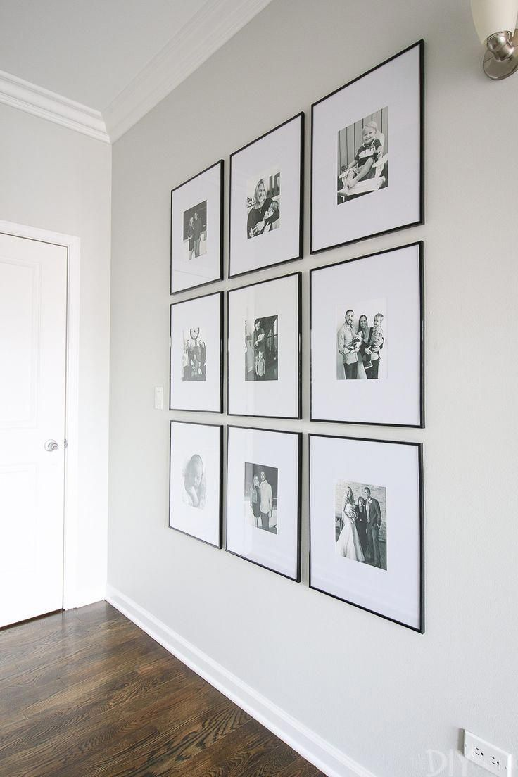 How to hang a symmetrical gallery wall in your hallway to make a statement on a blank wall. Tips to get the frames hung just right so everything is level! #gallerywall #livingroomdesign