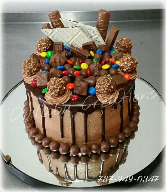 Chocolate Cake With Nutella Frosting And Dripping Ganage Candy Birthday Cakes Chocolate Cake Designs Chocolate Bar Cakes