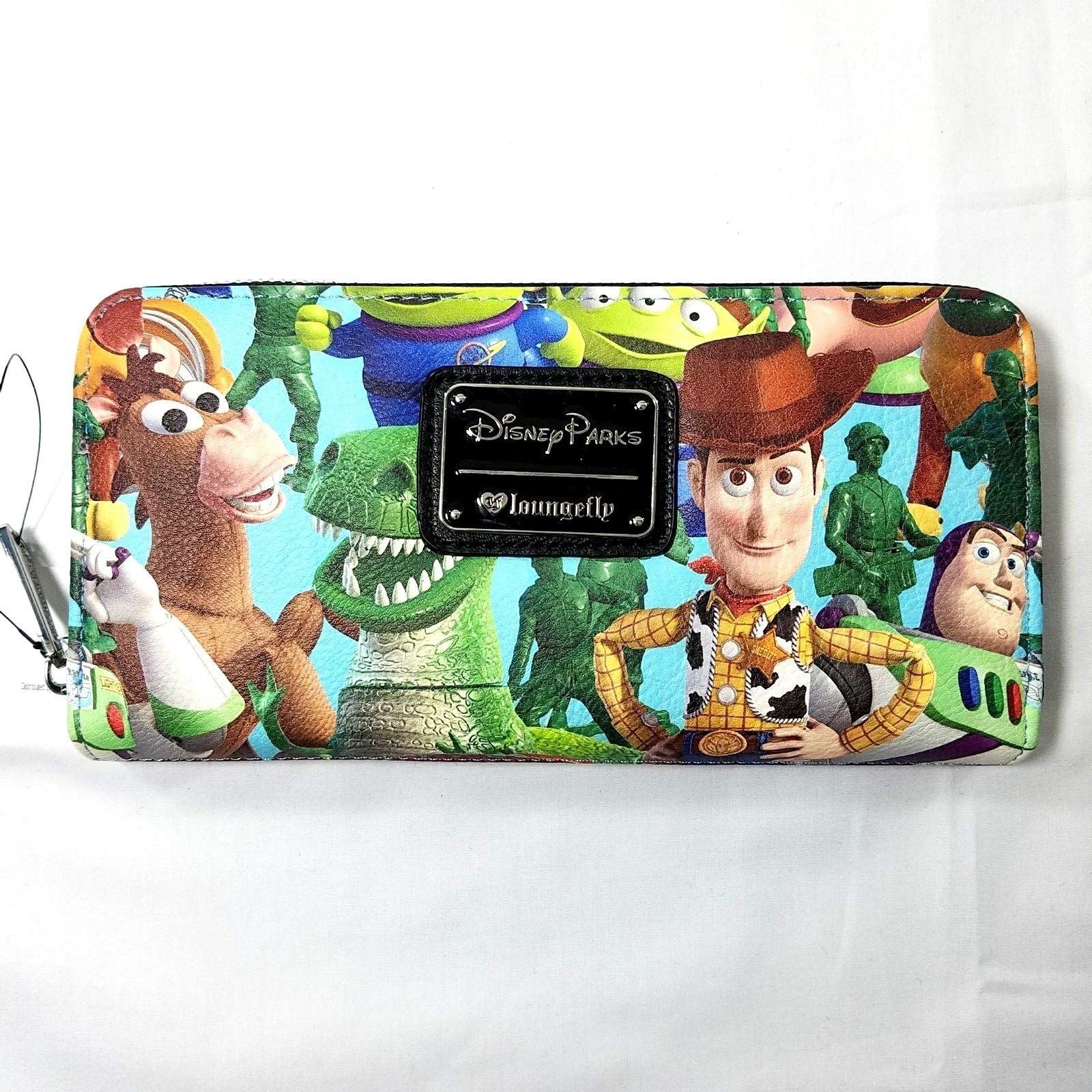 2c059918a4 Just Released Loungefly DisneyParks Exclusive Toy Story Print Zip Around  Wallet