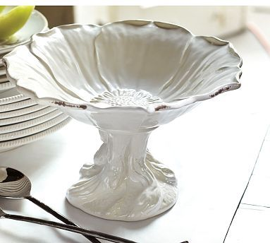 anything raised up on a stand is awesome for camera angles. flower footed serving bowl