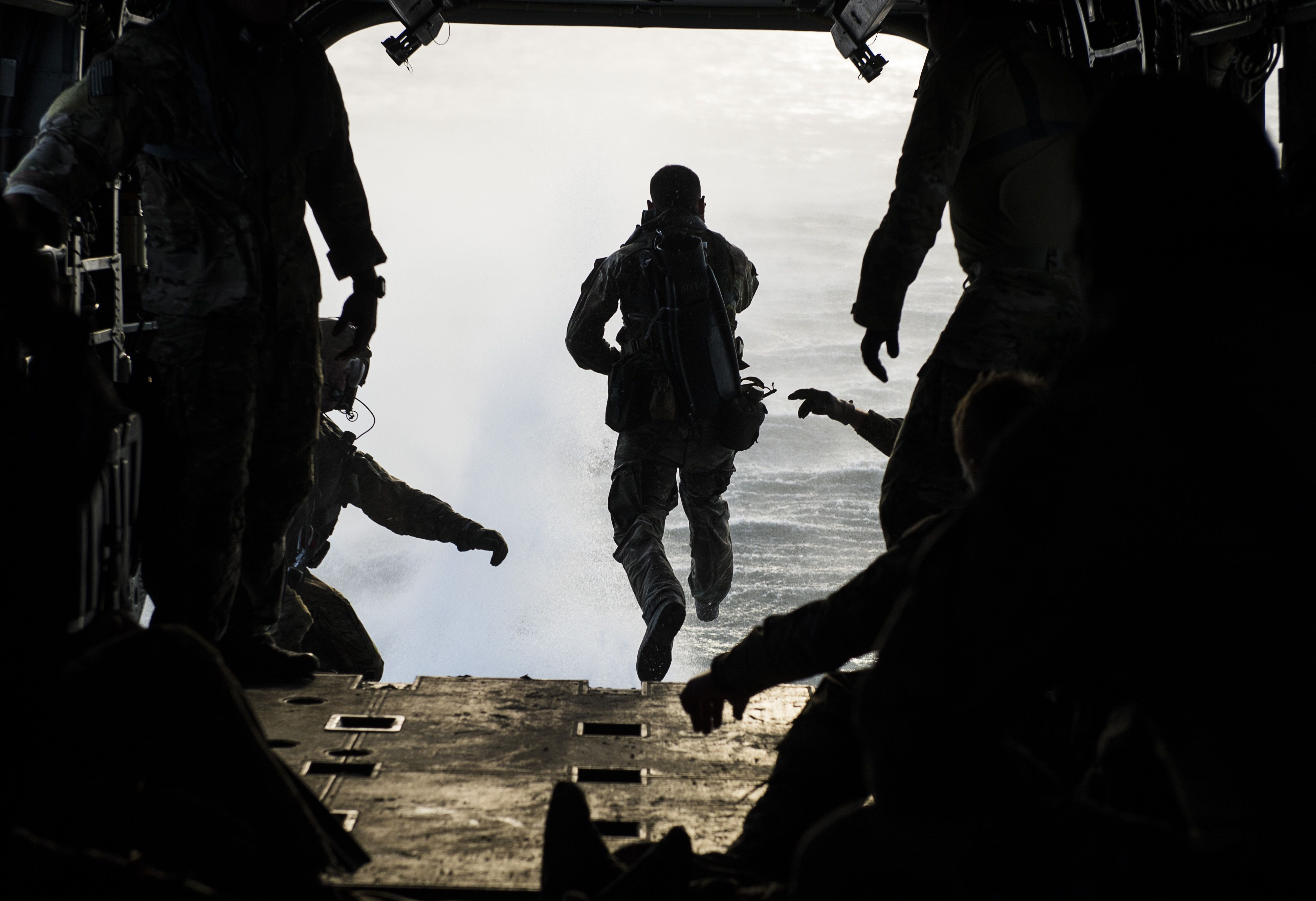 A member of the Chilean navy jumps from a CH47 Chinook as