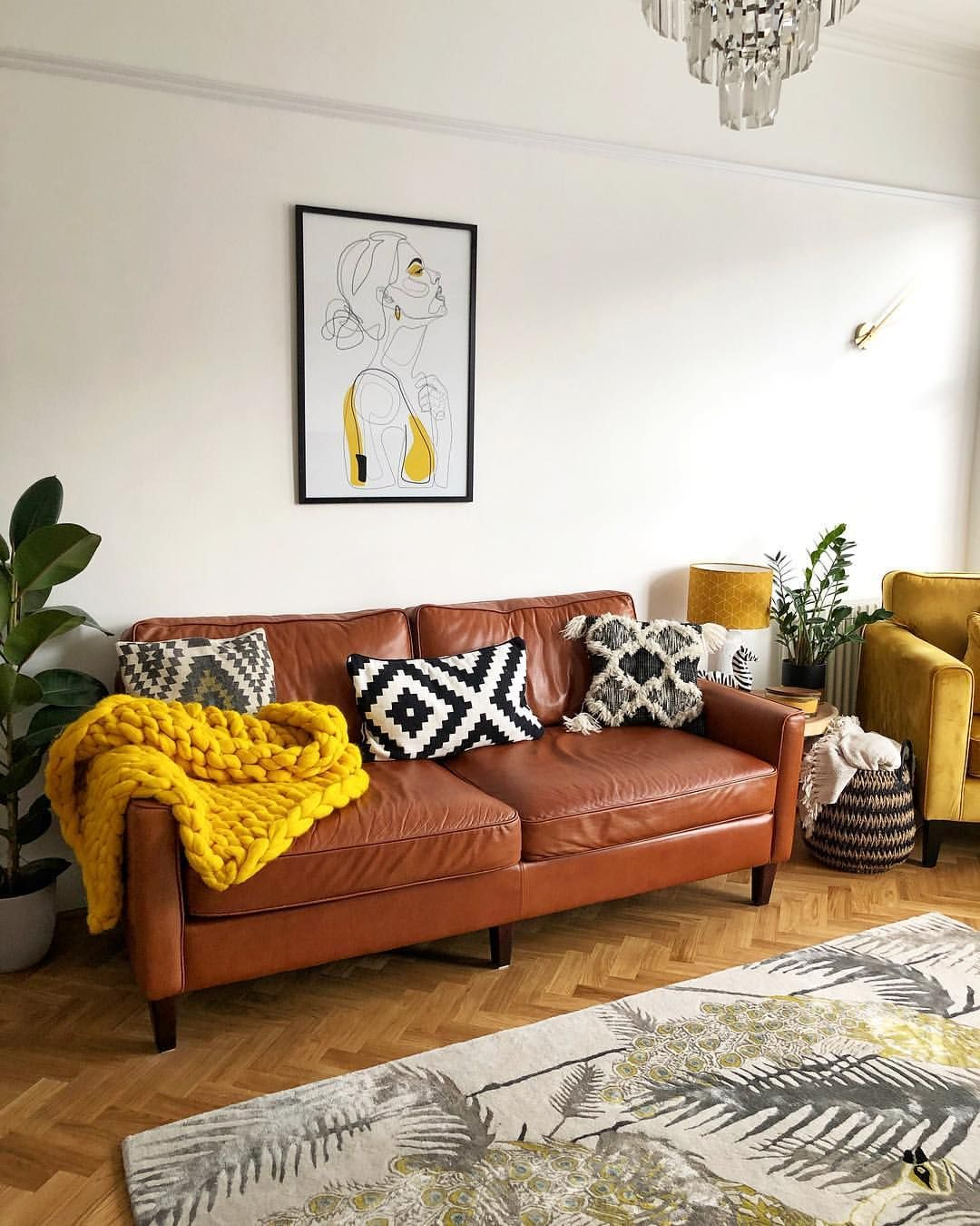 Living Room With Mid Century Style Tan Sofa Yellow Velvet Armchair And Yellow And Black Accessor Tan Sofa Living Room Leather Sofa Living Room Tan Living Room
