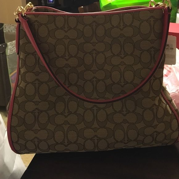 100% authentic coach 250$ New with tag. Brown signature fabric. Coach Bags Shoulder Bags