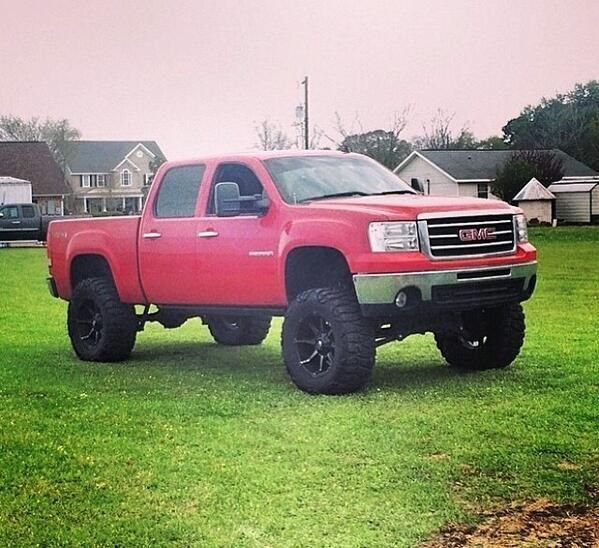 Lifted Red GMC Truck