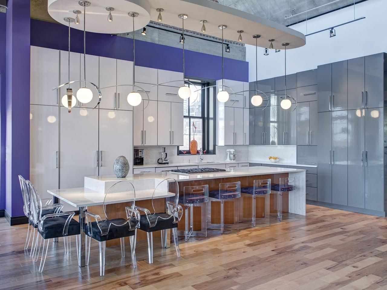 This oversized kitchen island provides plenty of seating for Open kitchen island with seating