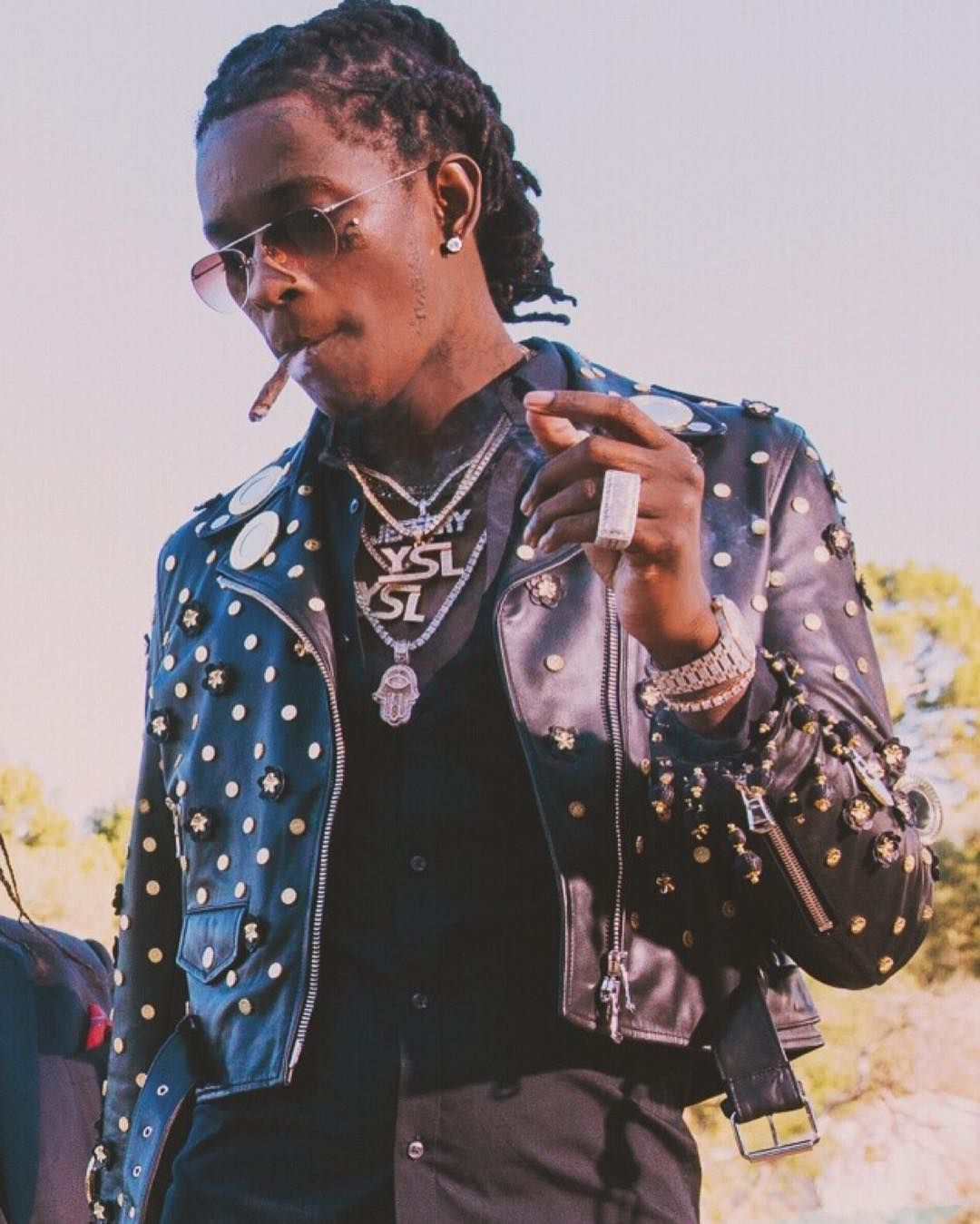a6948aa8478 Young Thug Wears Moschino Studded Leather Jacket and Timberland Boots