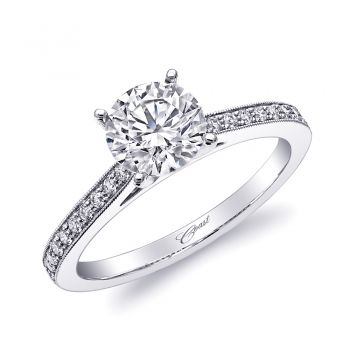 A classic and elegant engagement ring featuring fine pave diamonds on the shoulders of the ring, accented by milgrain edging. Shown with a 1CT center stone.