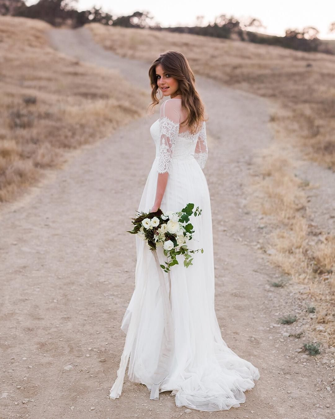 For the bohemian inspired bride a long flowing aline dress with