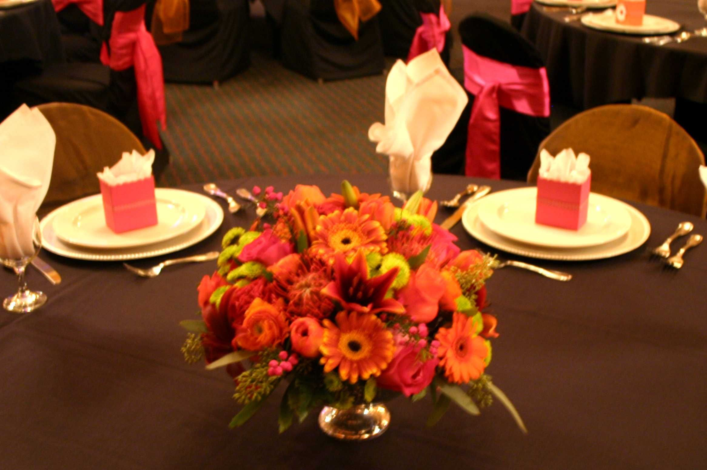 Orange traditional wedding decor  Traditional Centerpiece by Suzanne for wedding show   Floral