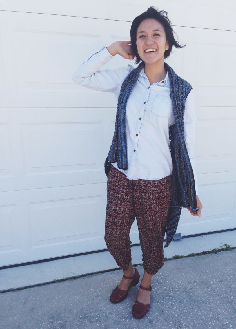 Bira's knitted vest, washed out Jean shirt, hippie pants, red Clark's