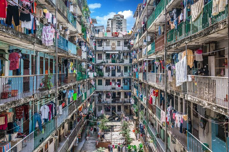 MARCH 4, 2017. Laundry Angles  By Kenny Ngai.  The balconies of the San Mei On residential complex show crammed quarters on the autonomous Chinese peninsula of Macau. With around 54,954 people per square mile, it's the most densely populated city in the world.