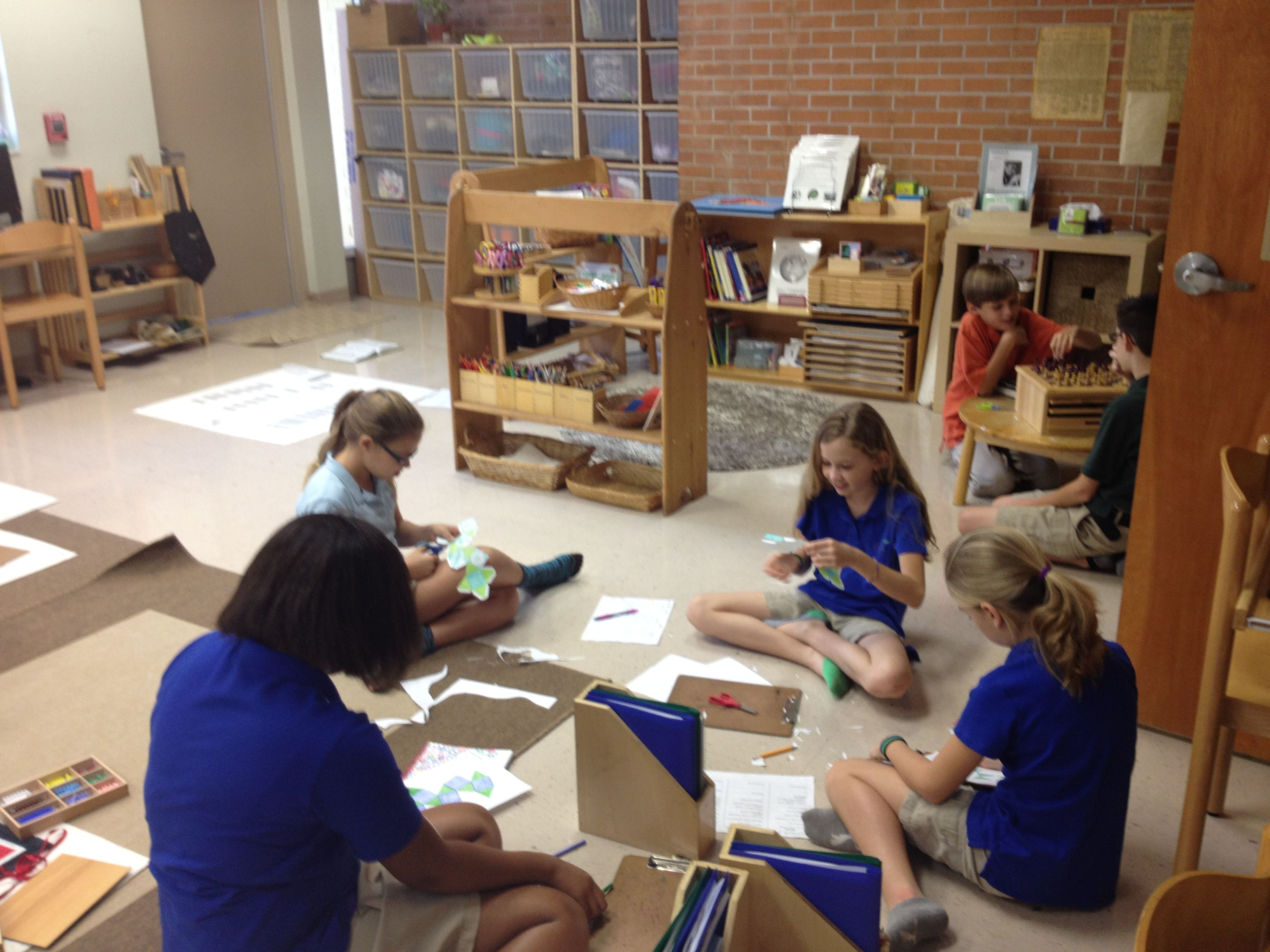 upper elementary Montessori students working with Archimedean solids Lakeland Montessori in Lakeland FL