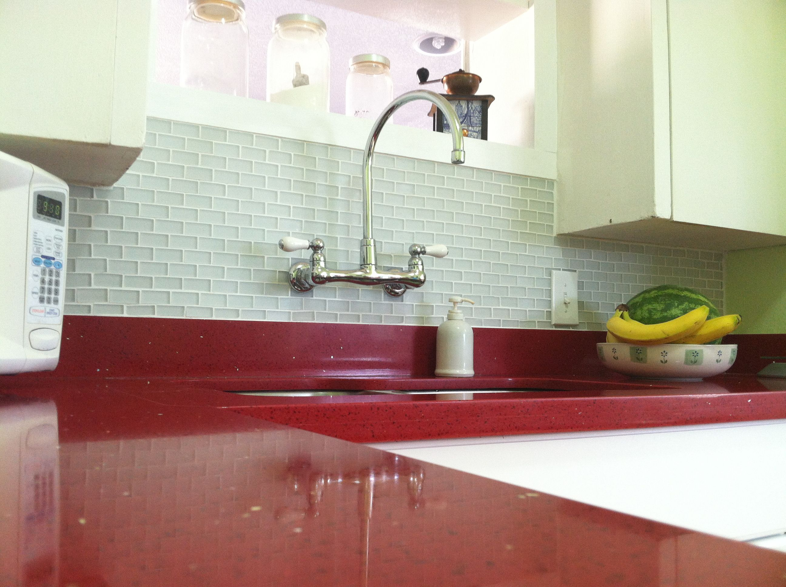frosted glass tile kitchen glass kitchen backsplash I love our new red sparkly quartz countertops paired with our white frosted glass subway tile backsplash