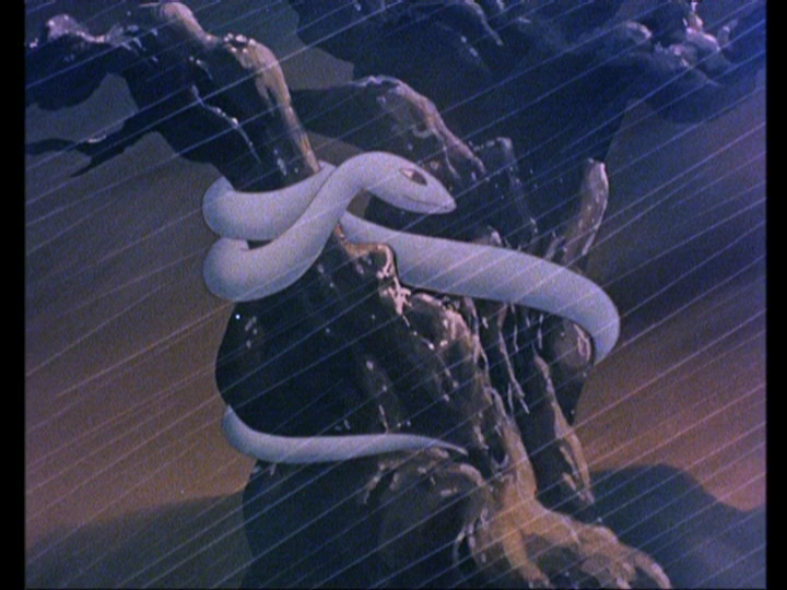HAKUJADEN   White serpent in the rain. She will transform into a maiden with magical powers.   From an anime from 1958.