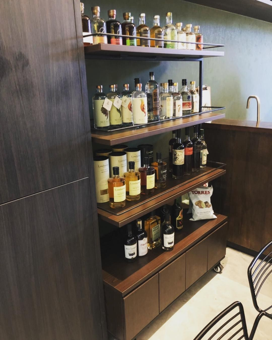 Mobile Display Stand For Liquor Bottles Complete With A Storage
