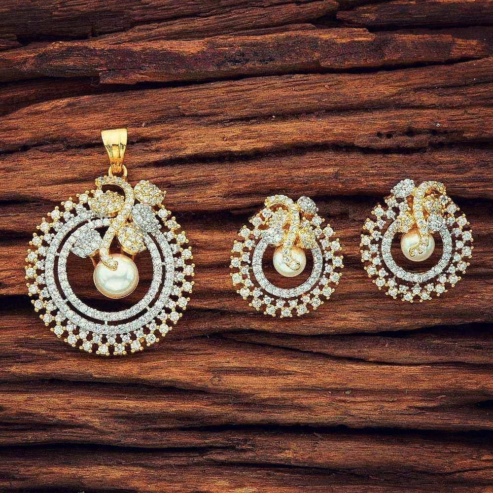 e86adcad85 Gorgeous double tone sparkling cubic zirconia and gold plated handcrafted  pendant and earrings set from Sajaa Online Indian Jewellery Boutique.