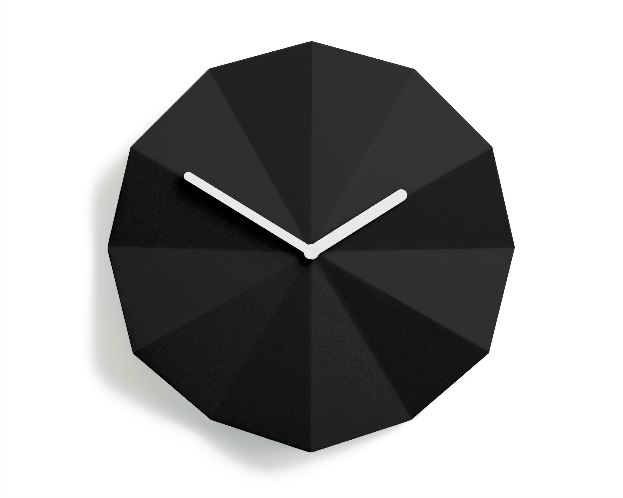The lawa delta clock is a modern wall clock that interacts the lawa delta clock is a modern wall clock that interacts beautifully with light the folds in the surface of the minimalistic design indicate the hours of amipublicfo Choice Image