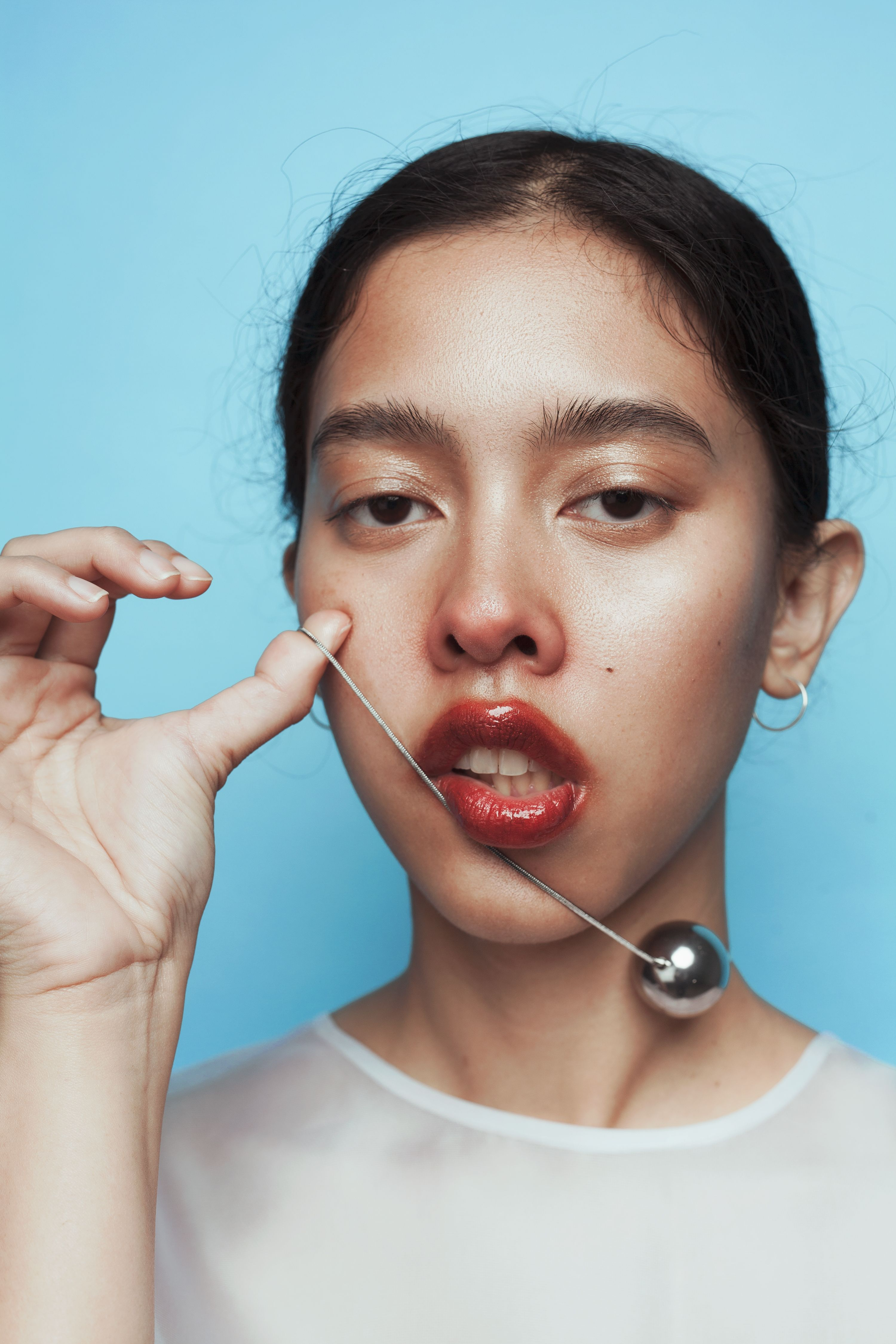 Ashanti photographed by Gia Weaver, makeup and hairstyling by Josie Hanuska #fluffyhair #lollipoplips #sheershirts #redlips #copper #glowingskin #glossylips #smudgylips #fashion #portrait #melbournemodel #rednose #soft #editorialmakeup #editorial #glossymakeup #blue #fluffybrows