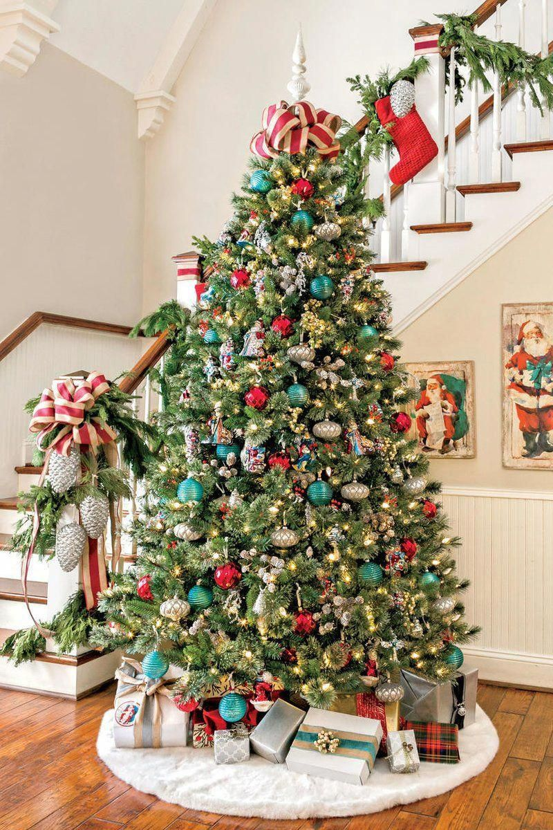 Our Favorite Holiday Drama: Gorgeous Trees! Use our traditional and themed Christmas tree decoration ideas to make your tree extra special this holiday season.