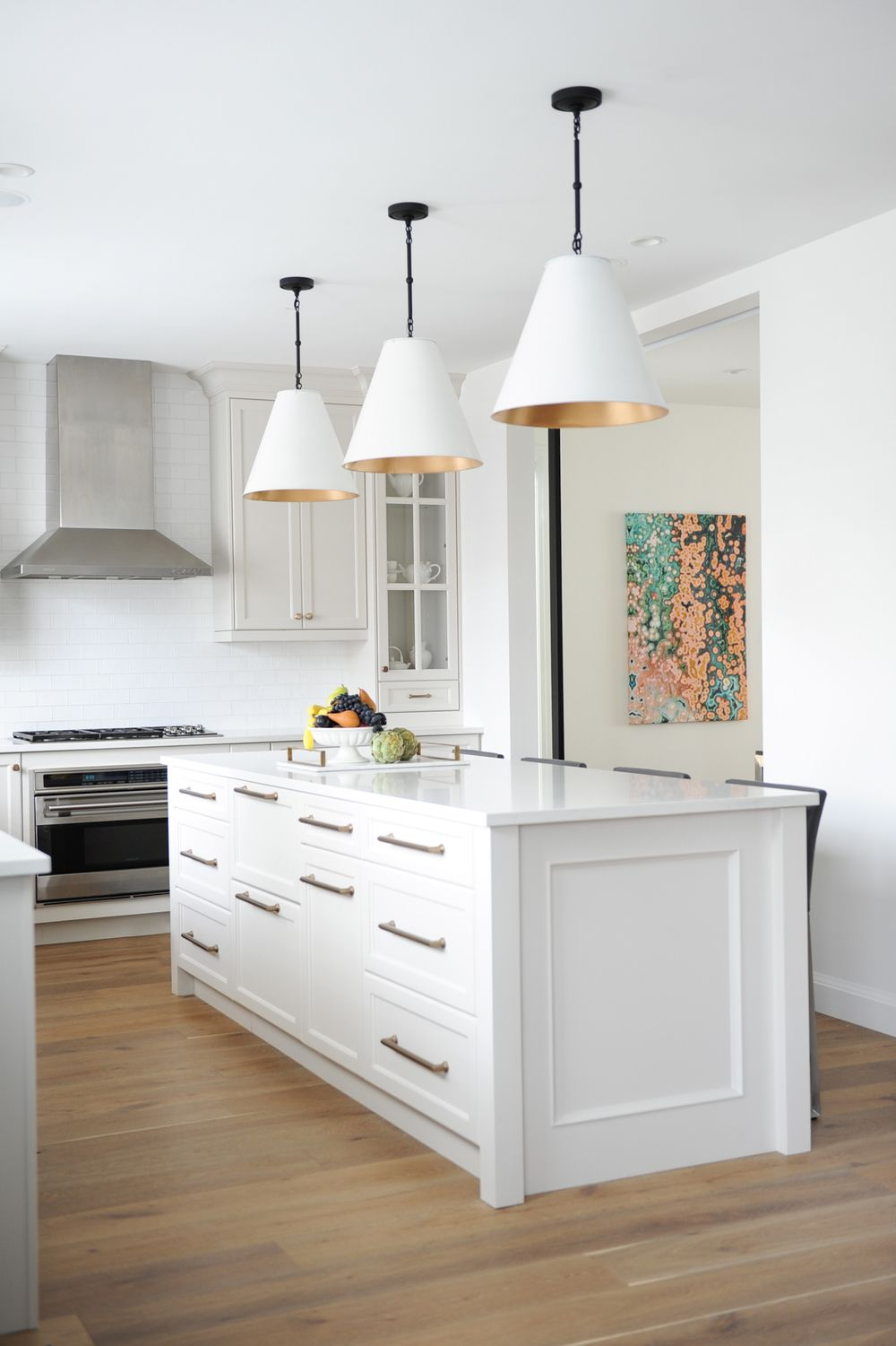 Large kitchen island in light taupe large gold and ivory pendant